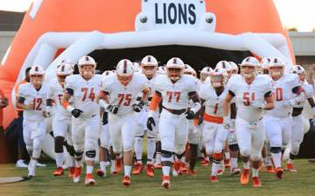 Lions Get Key District Road Win 28-14
