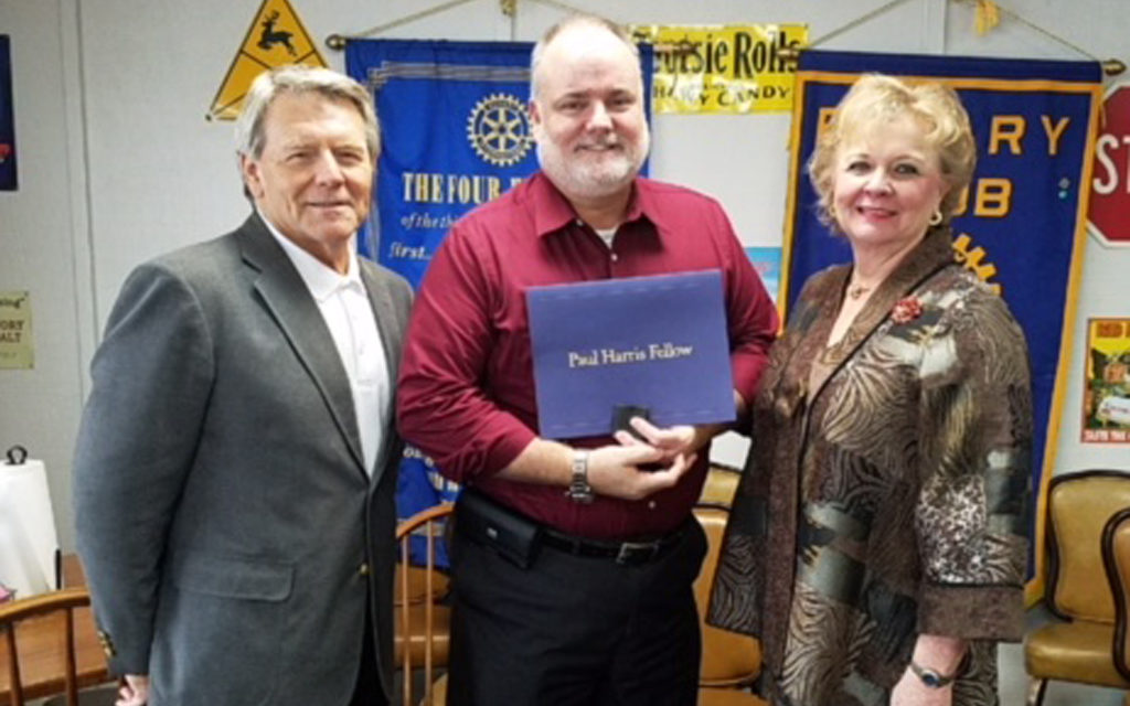 Rotarians present Paul Harris Fellow Award to Ron Hunt