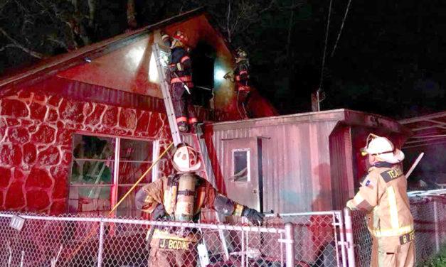 Firefighters Battle Blaze in New Year's Eve House Fire