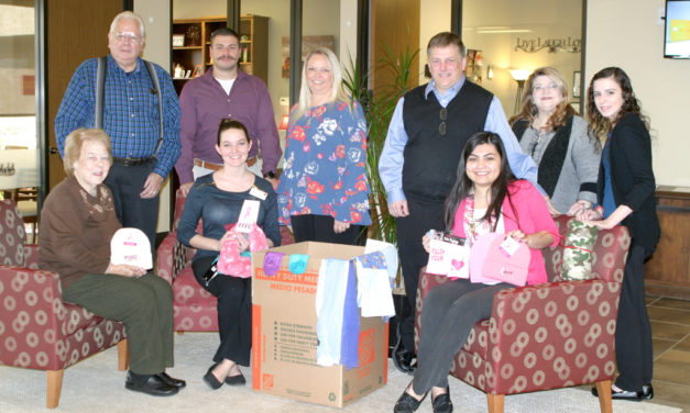 Bank Employees Collect Items for Local Cancer Patients